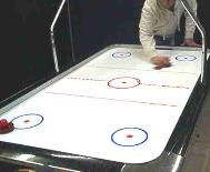 Air Hockey Table in Action Chris Nordman Associates