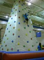 Rockwall climbing wall inflatable game in action